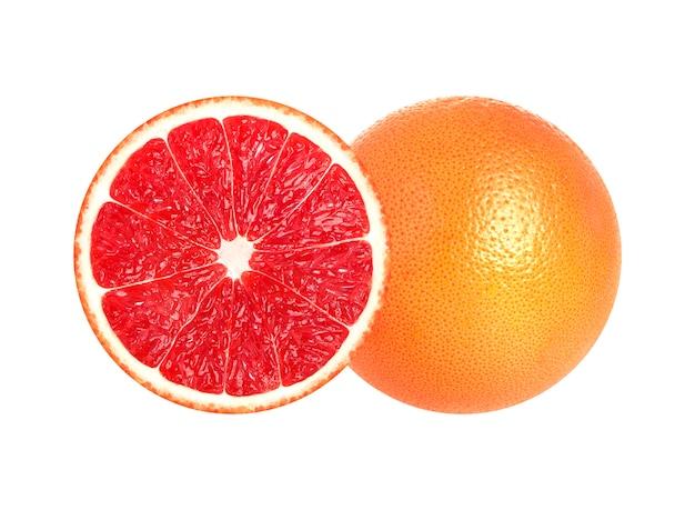 De helft van grapefruit op witte achtergrond wordt geïsoleerd die Premium Foto