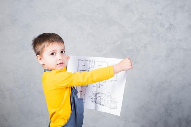 De holdingsdocument van de jongensbouwer met project Gratis Foto