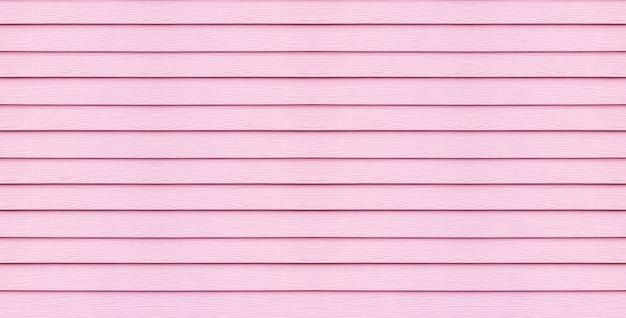 De houten raad van de close-upoppervlakte bij de roze achtergrond van de muurtextuur Premium Foto
