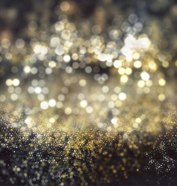 De kerstmisachtergrond van bokehlichten en schittert Gratis Foto