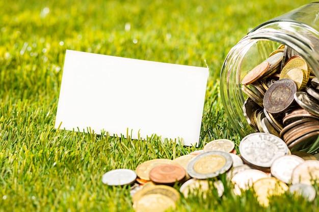 De munten op glazen pot Gratis Foto
