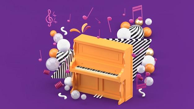 De oranje piano is omgeven door noten en kleurrijke ballen op de paarse. 3d render Premium Foto