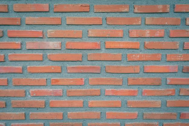 De oude achtergrond van het bakstenen muurblok Premium Foto
