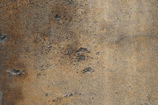 De oude concretegrunge beschimmelde achtergrond van de muurtextuur Premium Foto