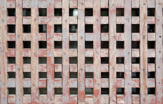 De oude houten textuur van de netmuur voor luchtventilatie Premium Foto