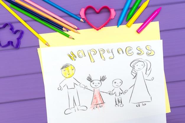 De schets van een kind van een gezin is geschilderd Premium Foto