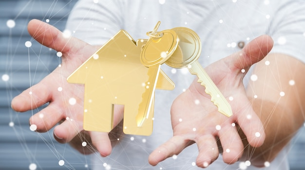De sleutel van de zakenmanholding met huissleutelring in zijn hand het 3d teruggeven Premium Foto