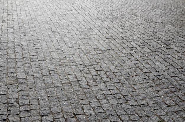 De textuur van de straatsteen (straatstenen) van velen Premium Foto