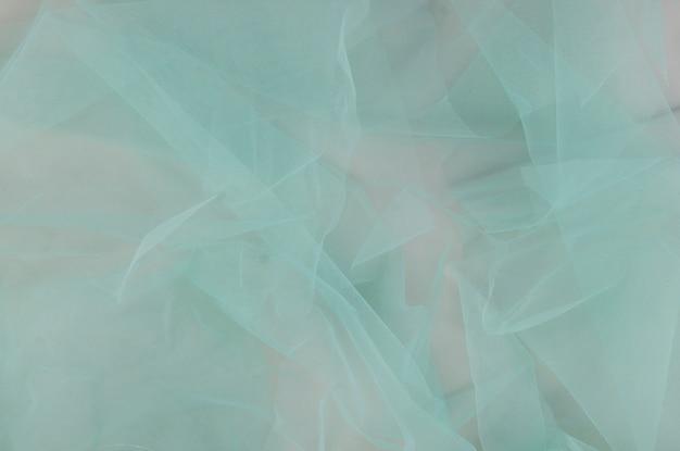 De textuurachtergrond van de close-up zachte stof Gratis Foto