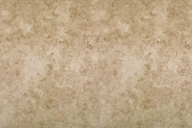 De textuurachtergrond van de steen in bruine tonen. Premium Foto