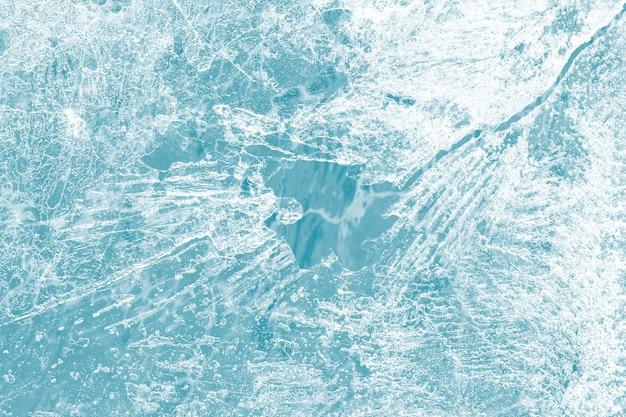 De textuurmacro van de ijsoppervlakte die op een blauw behang wordt geschoten Gratis Foto