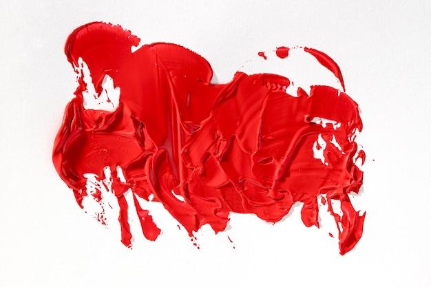 De vlek van de abstracte kunst heldere rode verf Premium Foto