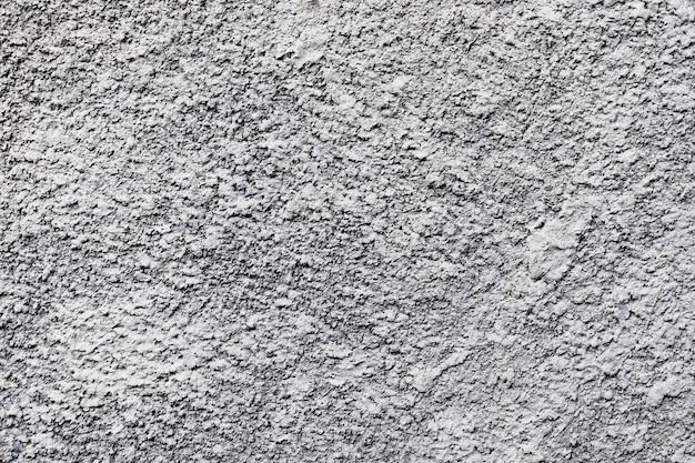 De witte grungy achtergrond van de muurtextuur met exemplaarruimte Gratis Foto