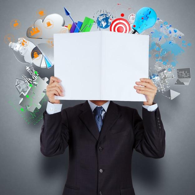 De zakenmanhand toont boek van succeszaken Premium Foto