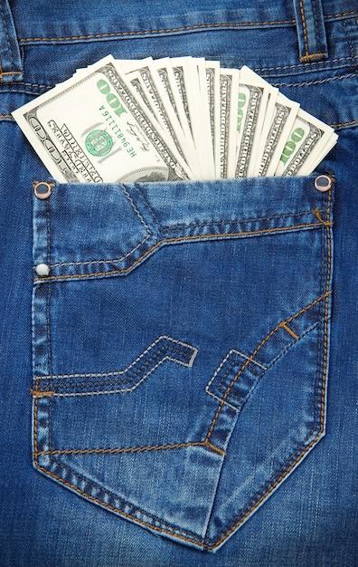 De zaktextuur en dollars van jeans Premium Foto