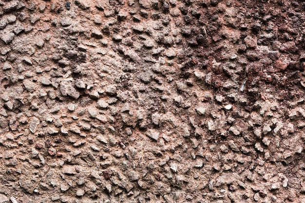 Decoratief ongelijk gebarsten echt stenen muuroppervlak Gratis Foto