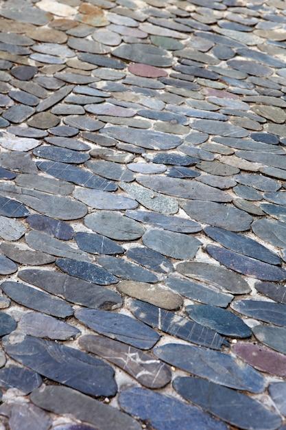 Decoratief vloerpatroon van ovale stenen Premium Foto