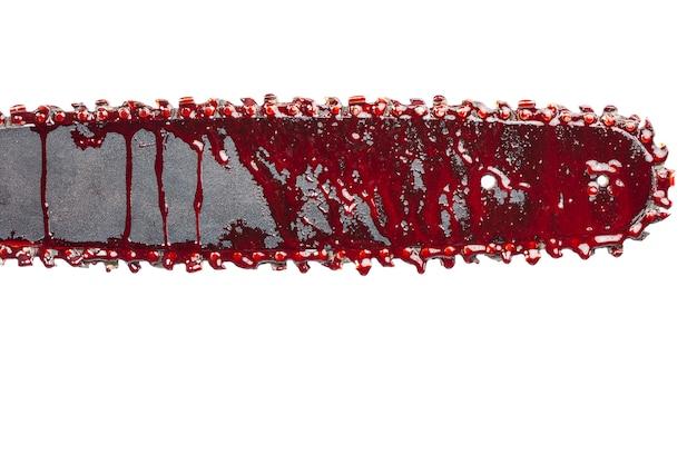 Detail van kettingzaag met bloed Premium Foto