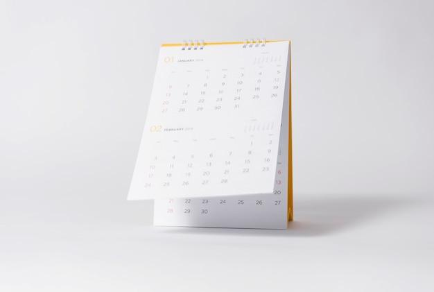 Document spiraalvormig kalenderjaar 2019 op grijze achtergrond. Premium Foto
