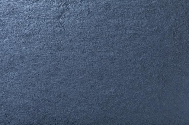 Donkerblauwe achtergrond van natuurlijke lei, textuur van steen Premium Foto