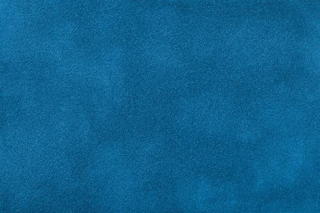 Donkerblauwe steenachtergrond van suèdestof, close-up. Premium Foto