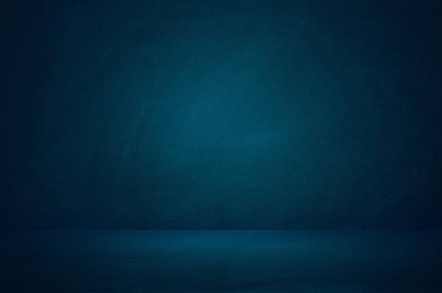 Donkerblauwe studioruimte achtergrond Premium Foto