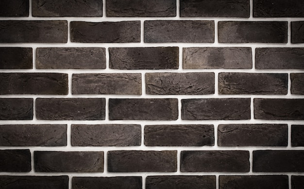 Donkerbruine bakstenen muur Gratis Foto