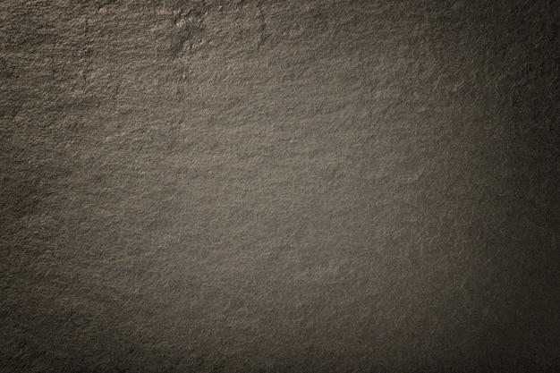 Donkere bronzen achtergrond van natuurlijke leisteen Premium Foto