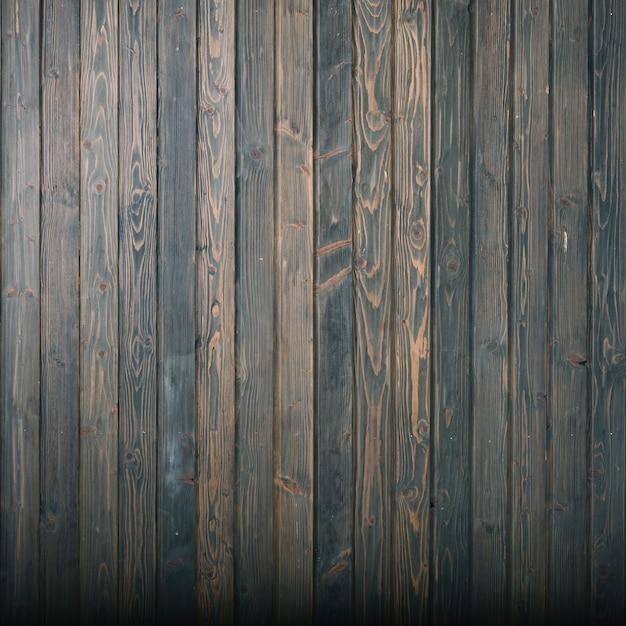 Donkere houten muurachtergrond Gratis Foto