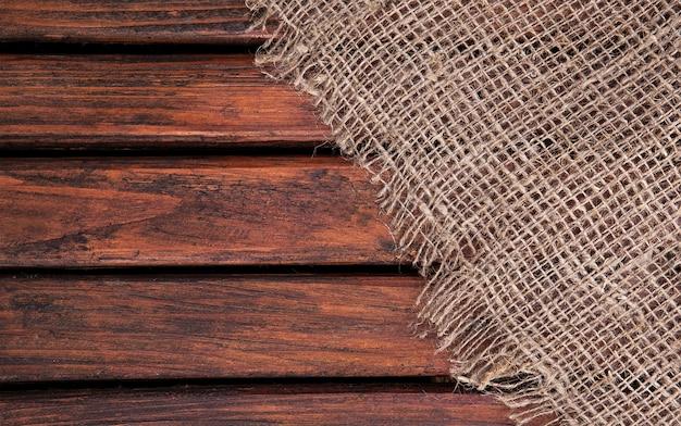 Donkere houtstructuur en stof. textiel en hout. textiel structuur. Premium Foto