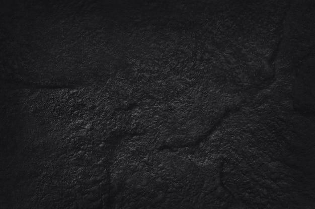Donkergrijs zwarte leisteen textuur met hoge resolutie, muur van natuurlijke zwarte stenen muur. Premium Foto
