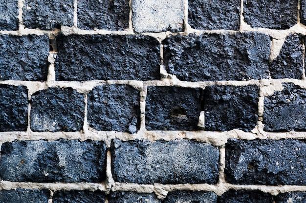 Donkergrijze grunge stonewall achtergrond Gratis Foto