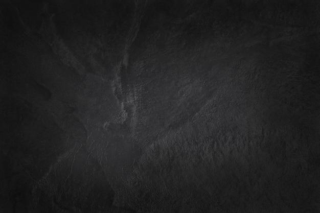 Donkergrijze zwarte leisteentextuur in natuurlijk patroon met hoge resolutie voor achtergrond en ontwerpkunstwerk. zwarte stenen muur. Premium Foto