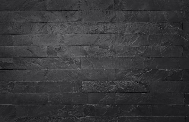 Donkergrijze zwarte leistextuur met hoge resolutie, achtergrond van natuurlijke zwarte steenmuur. Premium Foto