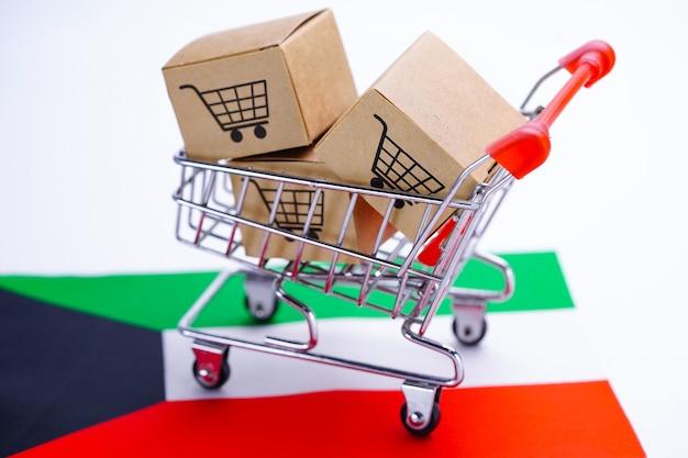 Doos met winkelwagen logo en vlag van koeweit. Premium Foto
