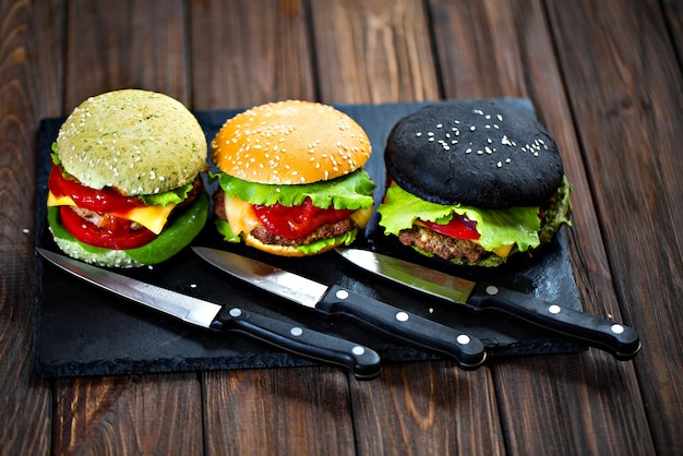 Drie heerlijke hamburgers Premium Foto