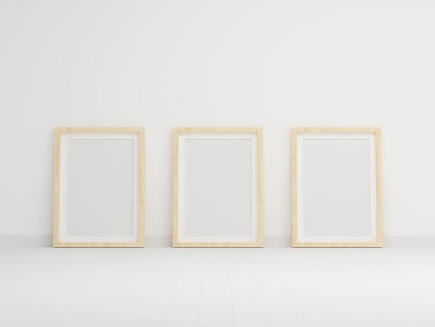 Drie leeg fotokader voor mockup in lege witte ruimte Premium Foto