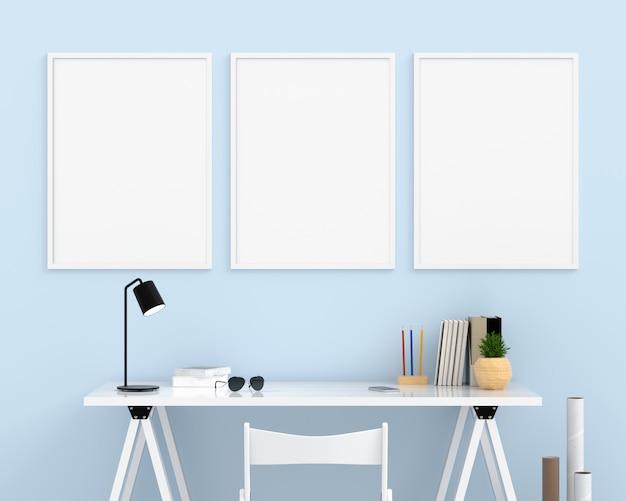 Drie lege fotolijstjes voor mockup op lichtblauwe muur Premium Foto