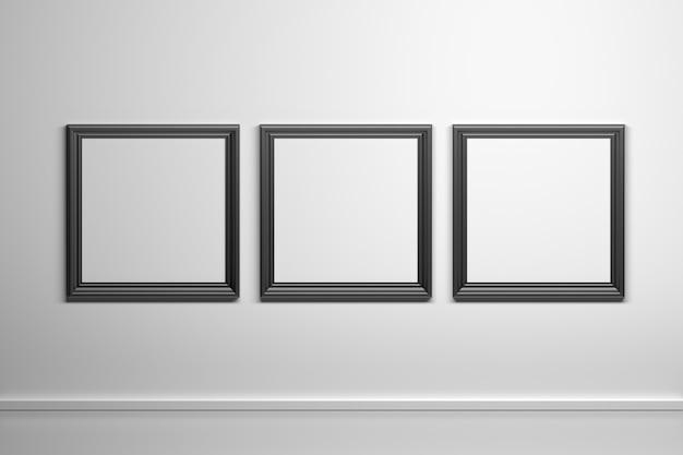 Drie zwarte vierkante gesneden kaders van de beeldfoto op de witte muur Premium Foto