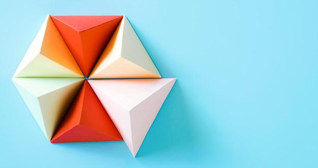 Driehoek origami papier vorm met kopie-ruimte Gratis Foto
