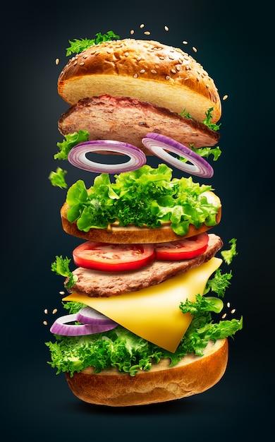 Drijvende hamburger geïsoleerd Premium Foto