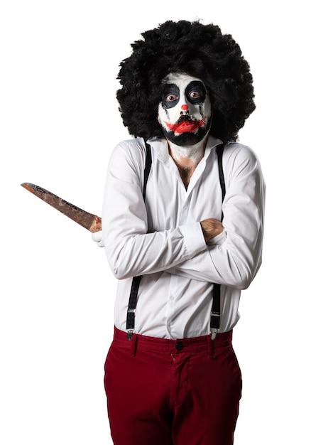 Droevige moordenaar clown met mes Gratis Foto