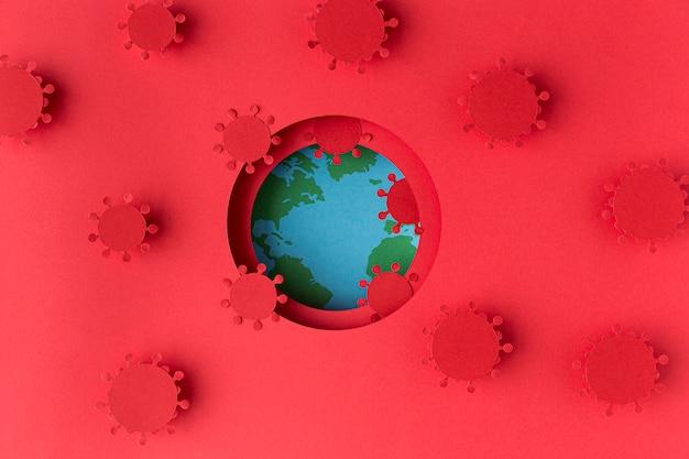 Earth globe gemaakt van papier met coronavirussen Gratis Foto