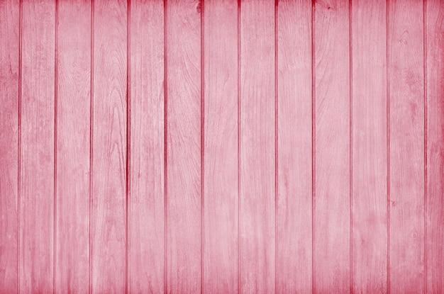 Een houten muur geschilderd in roze kleur Premium Foto