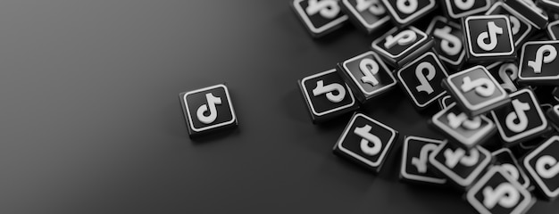 Een stel tiktok-logo's op zwart Premium Foto