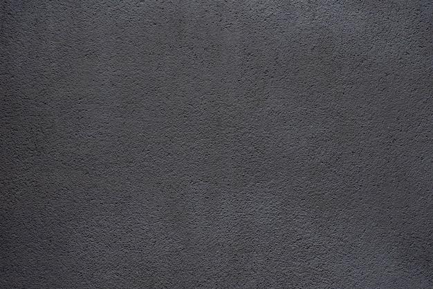 Eenvoudige achtergrond van zwart beton Premium Foto