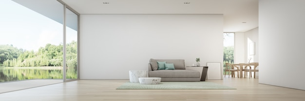 Eet- en woonkamer met uitzicht op het meer van een luxe zomerhuis met houten terras. Premium Foto