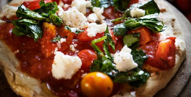 Eigengemaakt het receptidee van de pizzavoedselfotografie Premium Foto