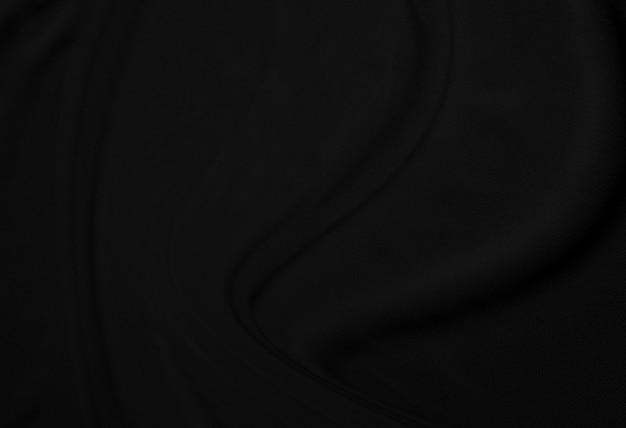 Elegante close-up verfrommeld van zwarte de doekachtergrond en textuur van de zijdestof. luxe achtergrondontwerp. beeld. Premium Foto