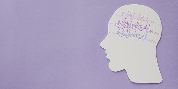 Encefalografie hersenpapier knipsel met paars lint, epilepsie bewustzijn, epileptische stoornis, concept van geestelijke gezondheid Premium Foto